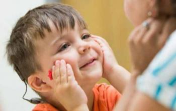 Ребенок с кохлеарным имплантом