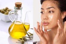 Польза оливкового масла для кожи - девушка наносит на кожу оливковое масло